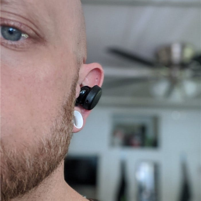 Show how far the earbud sticks out of my ear