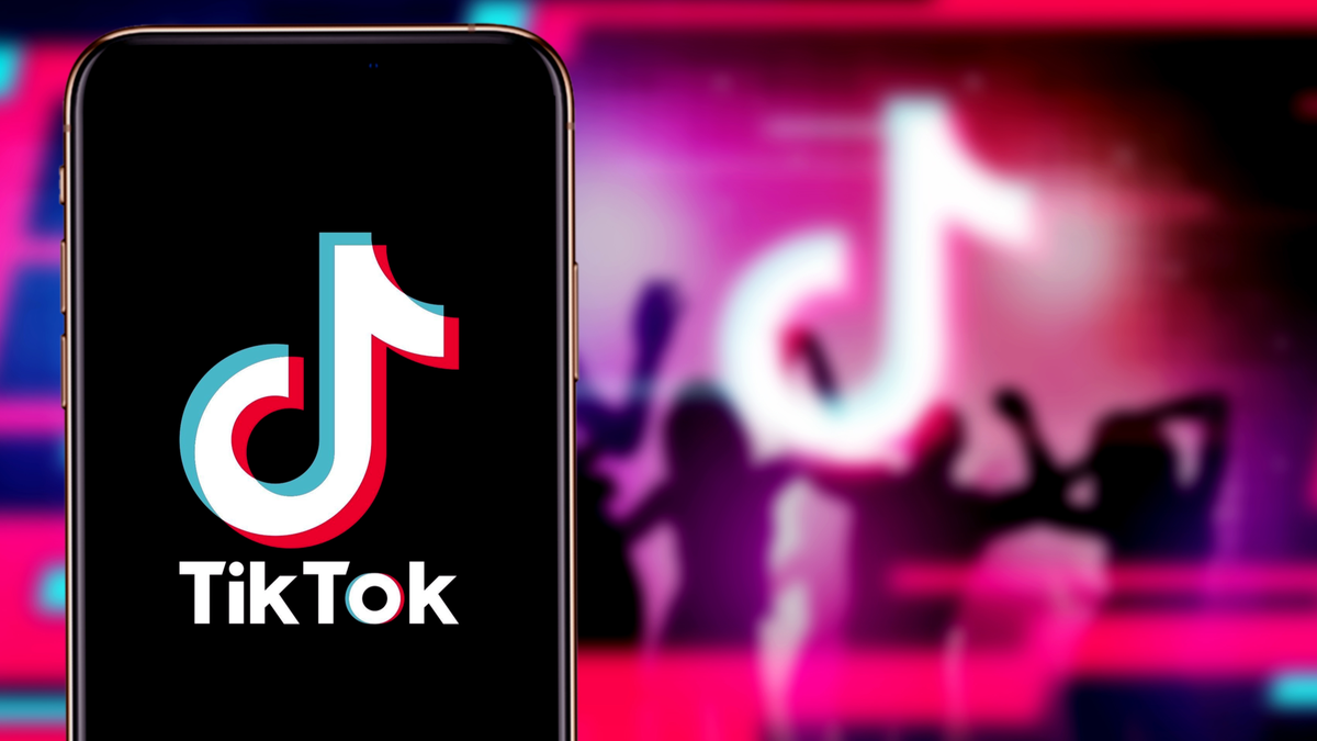The Best TikTok Alternatives TikTok app on iPhone infront of TikTok logo and silhouettes of people partying