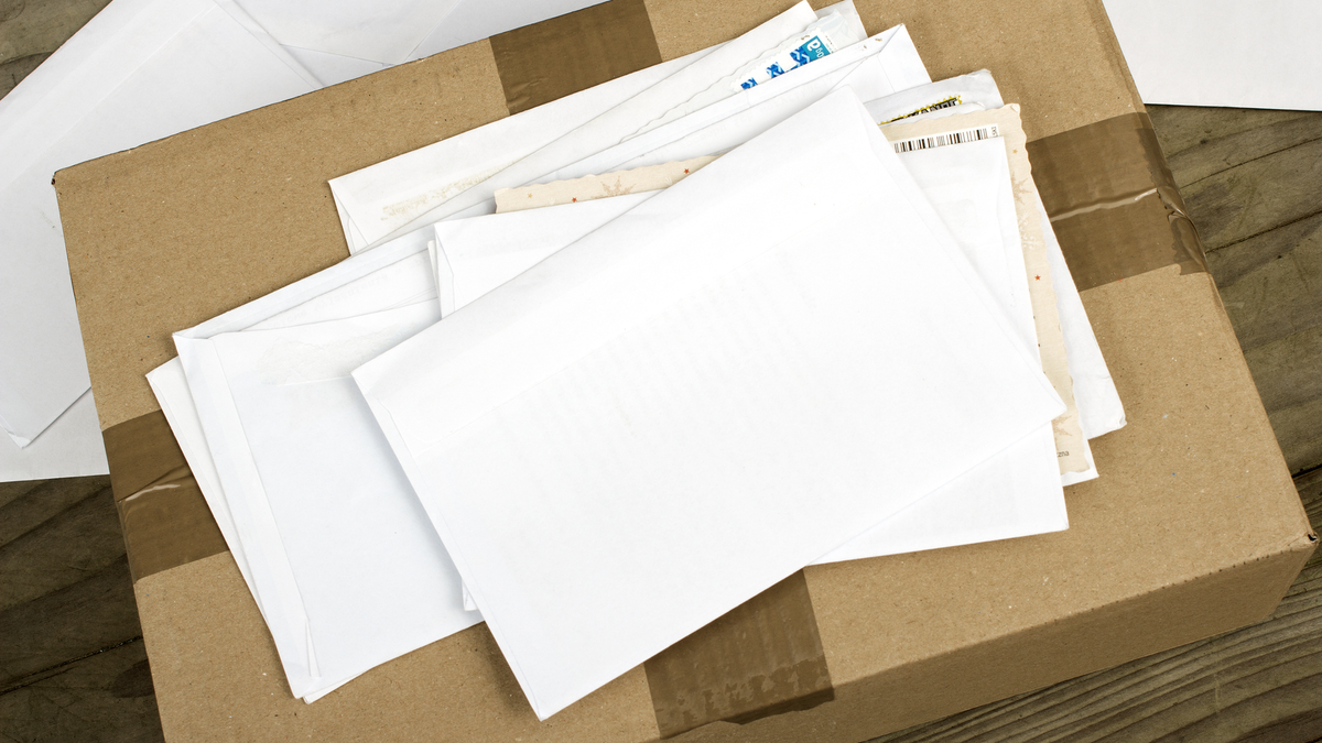 A pile of letters on top of a package