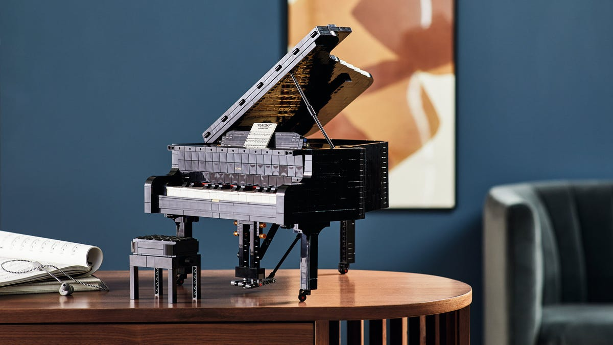 A LEGO grand piano on a desk.