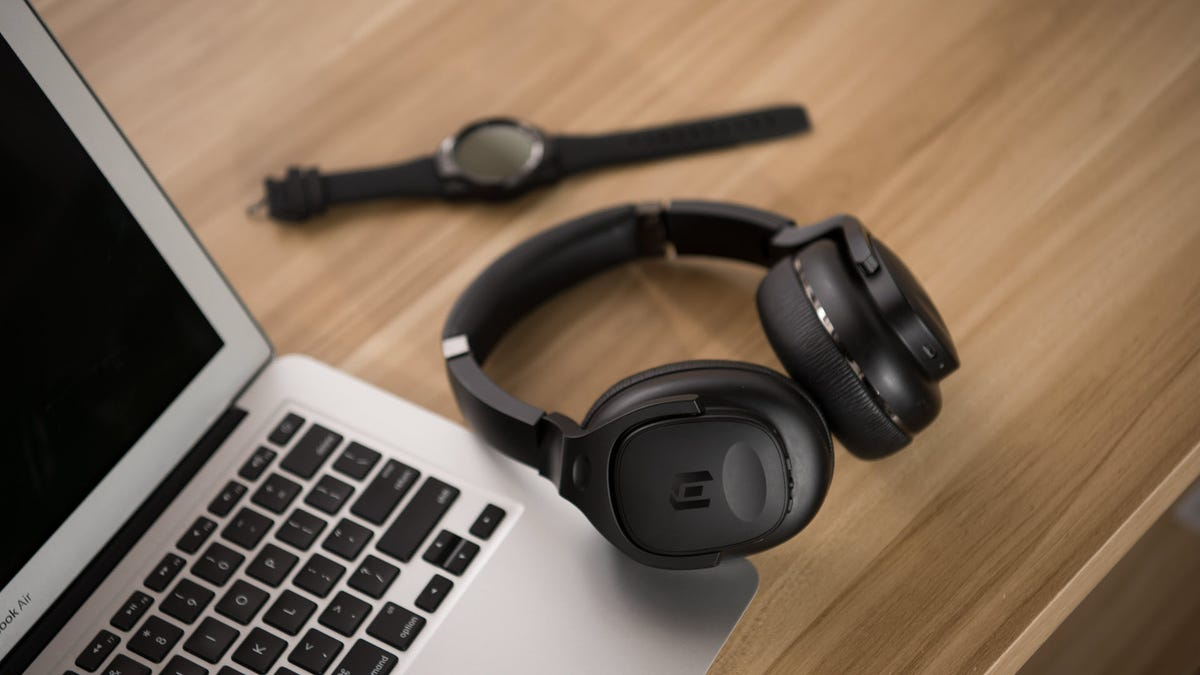 A set of TicKasa headphones next to a Macbook Air.