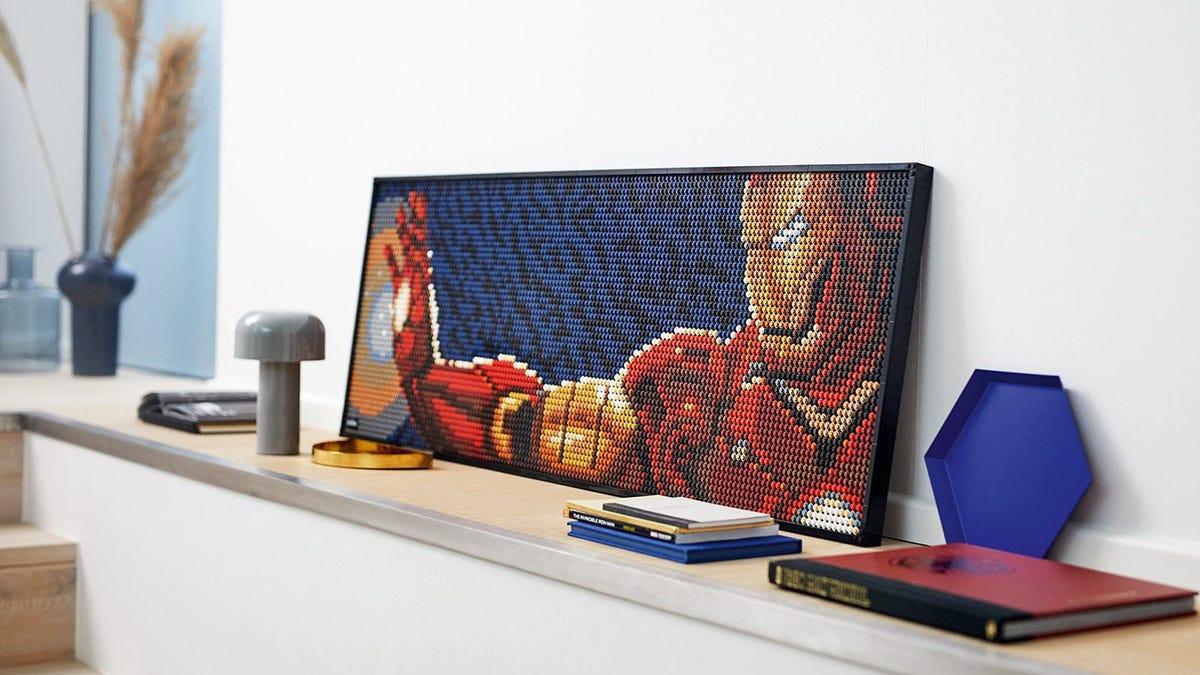 A LEGO Art poster featuring Iron man firing a blaster.