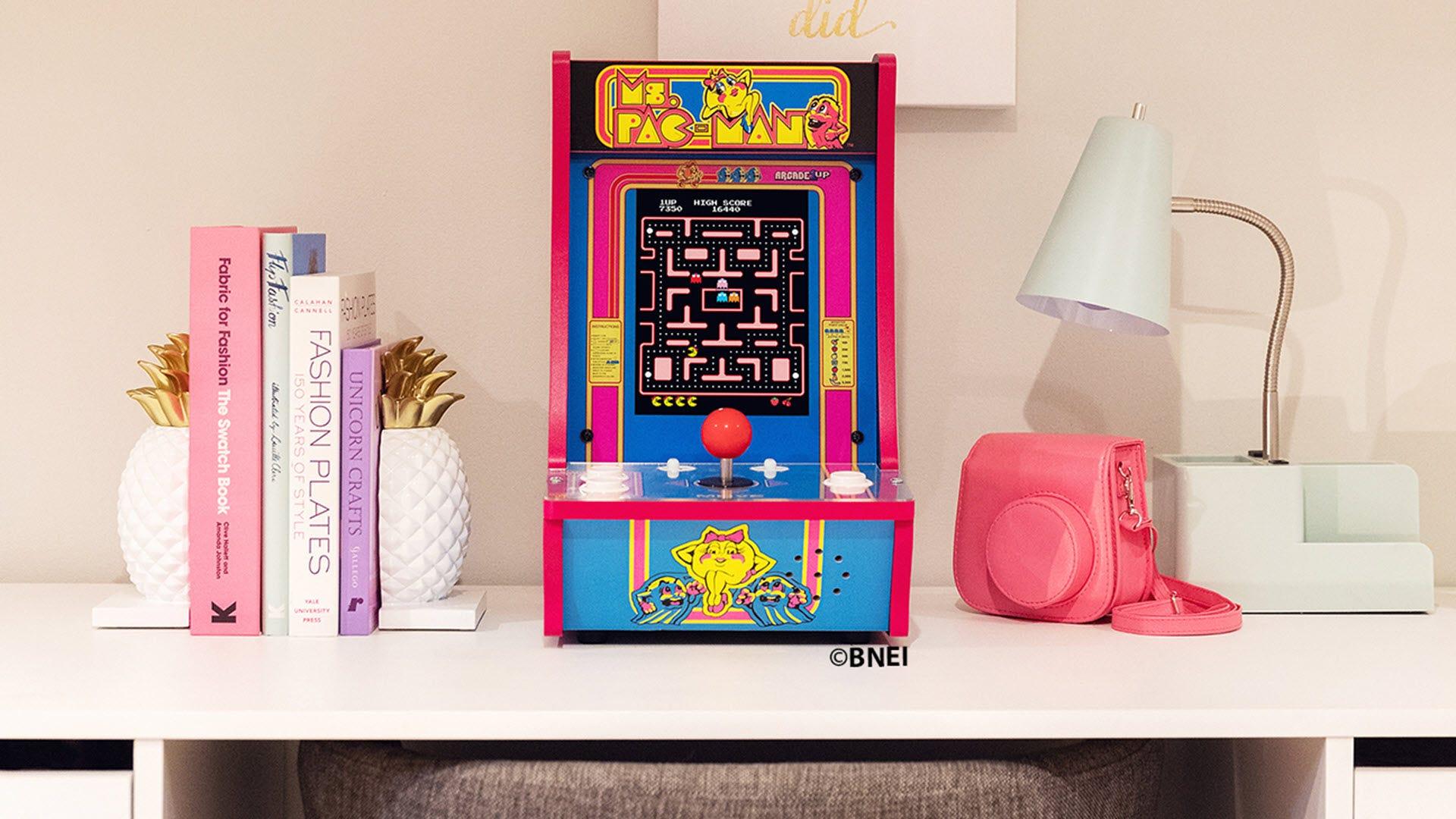 a 'Ms. Pac-Man' machine on a desktop.