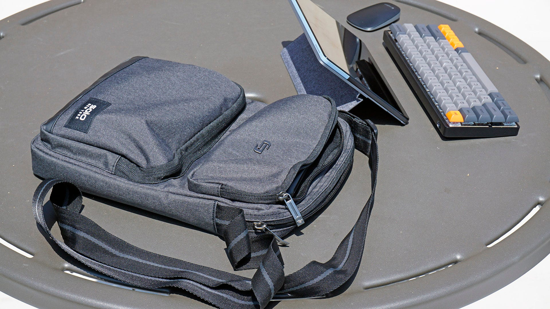 Ludlow tablet sling with computer on a table