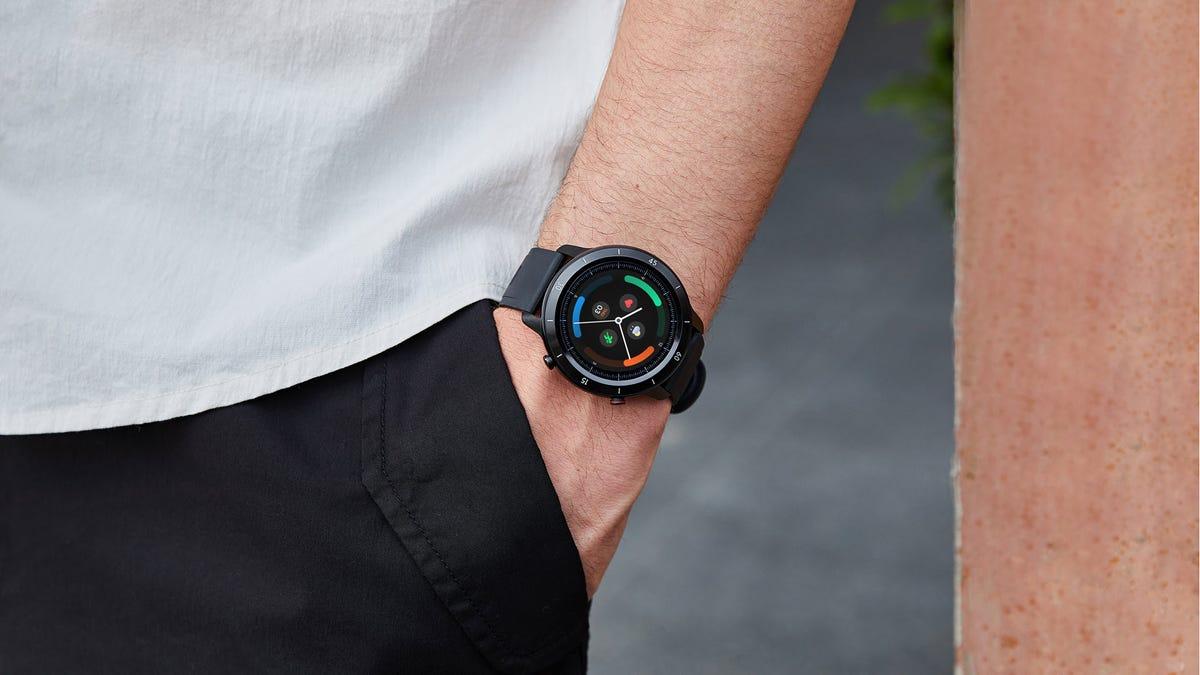 A Mobvoi TicWatch GTX on a man's wrist.