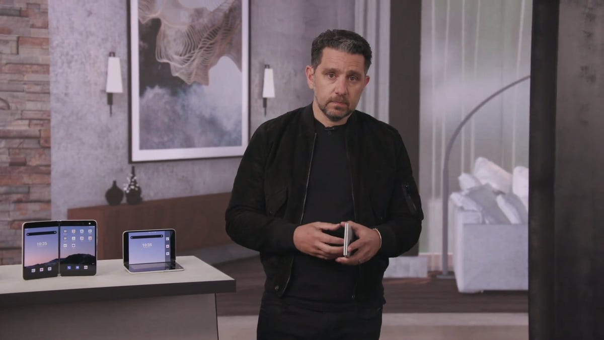 Microsoft Chief Product Officer Panos Panay holding and displaying a Surface Duo