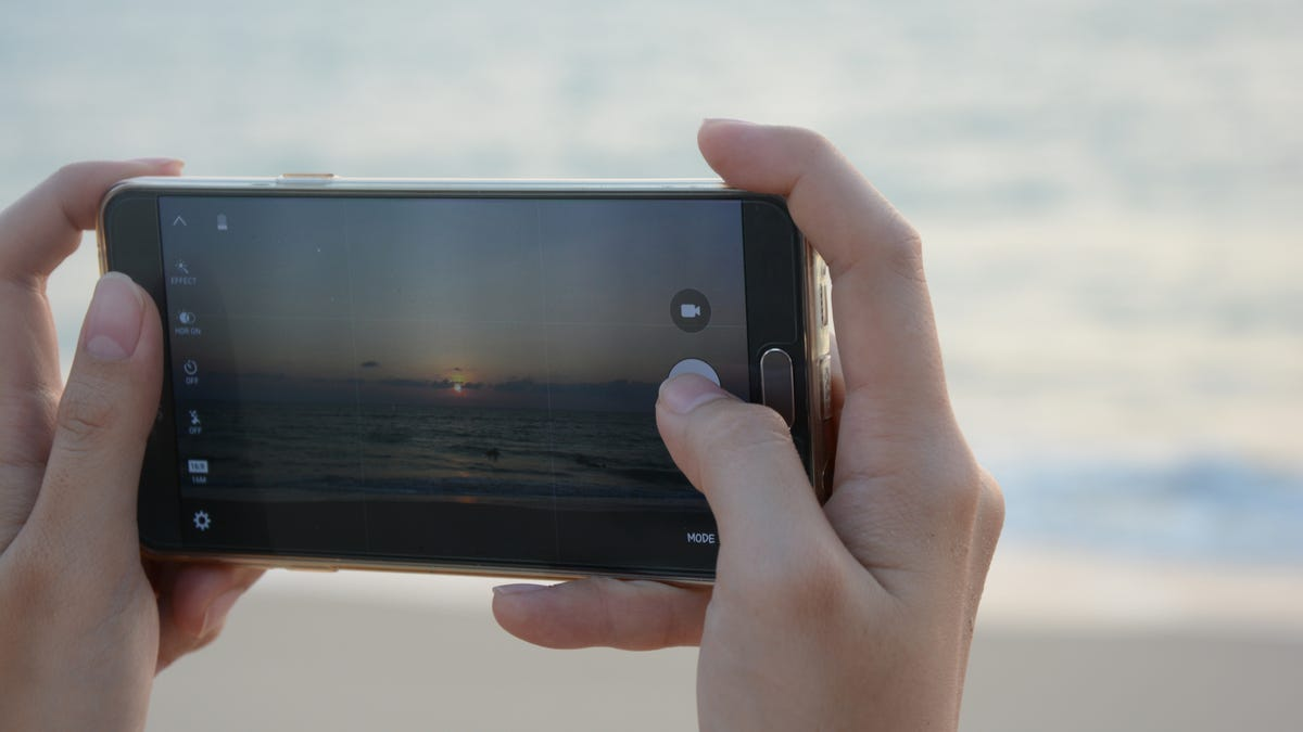 Phone taking photo of the beach