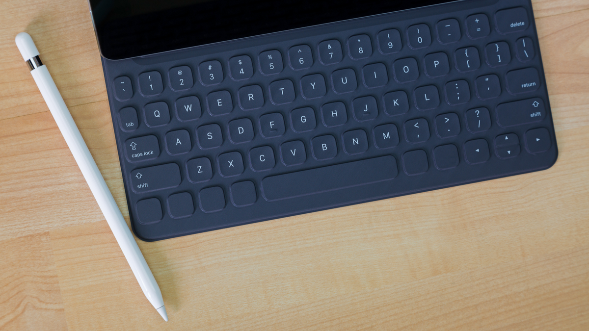 Apple Pencil sitting next to an iPad Pro Keyboard.
