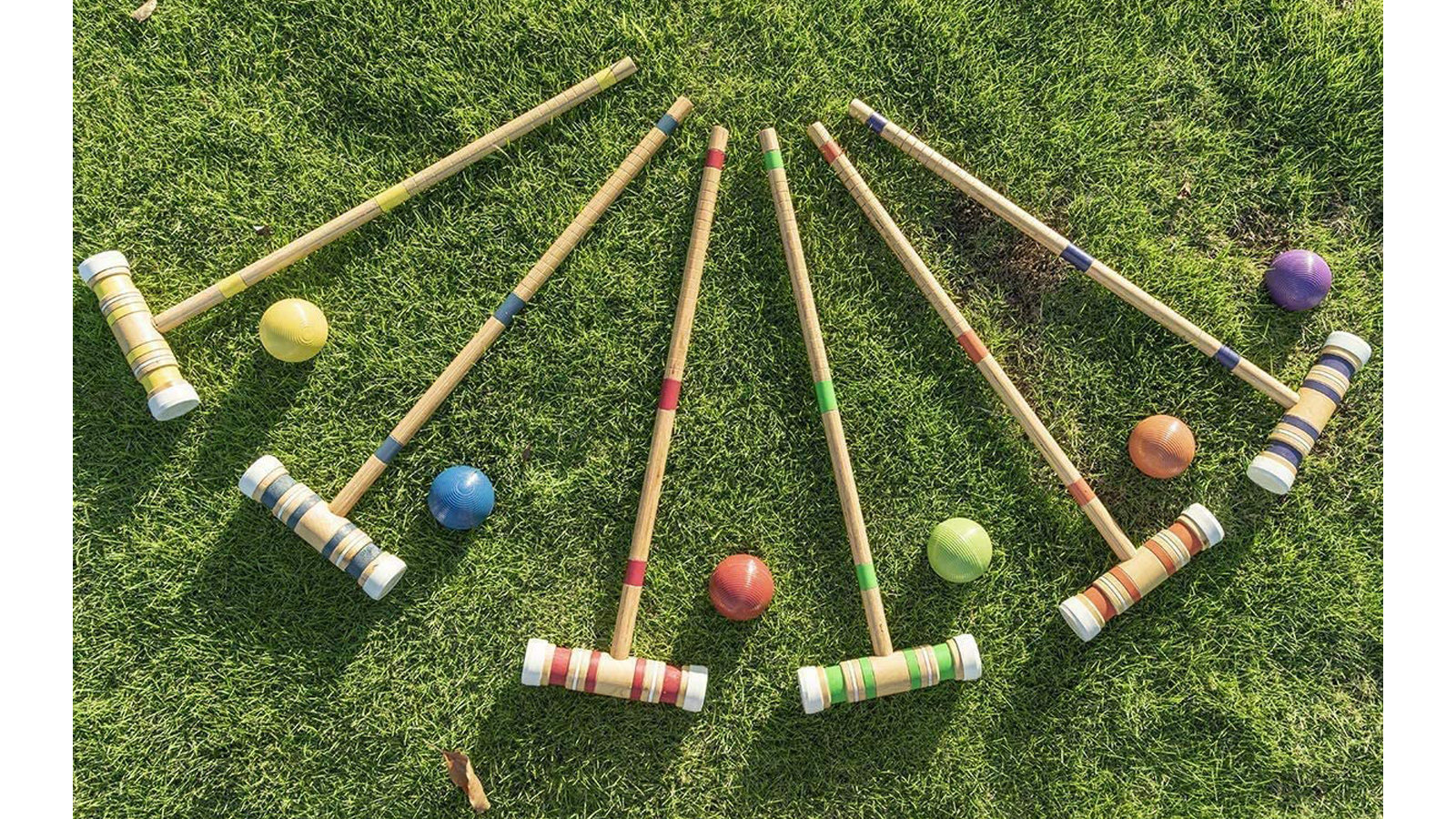 Croquet set with mallets, balls, wickets, and stakes