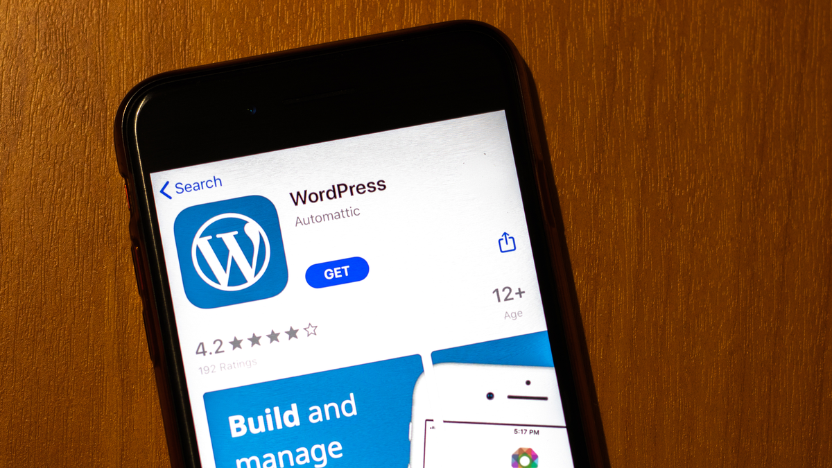 The WordPress app in the iOS store displayed on an iPhone.
