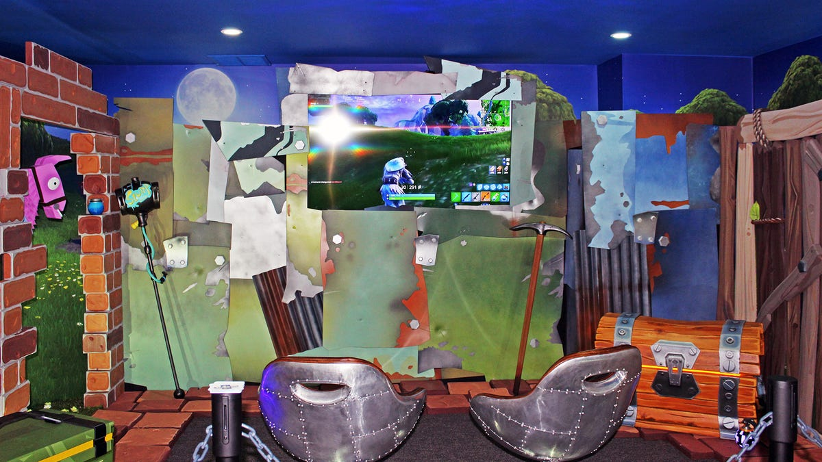 A video game room themed after Fornite