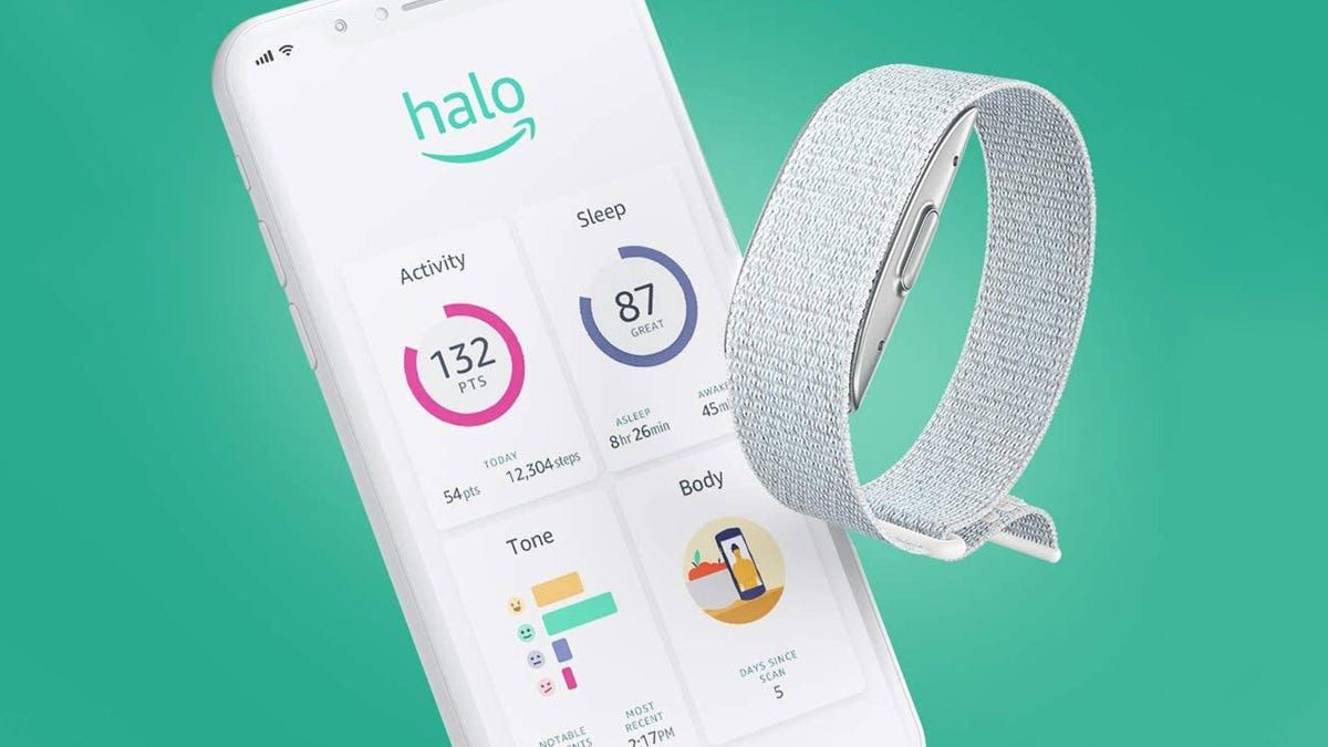 A Halo fitness tracker next to an iPhone with health stats on the screen.