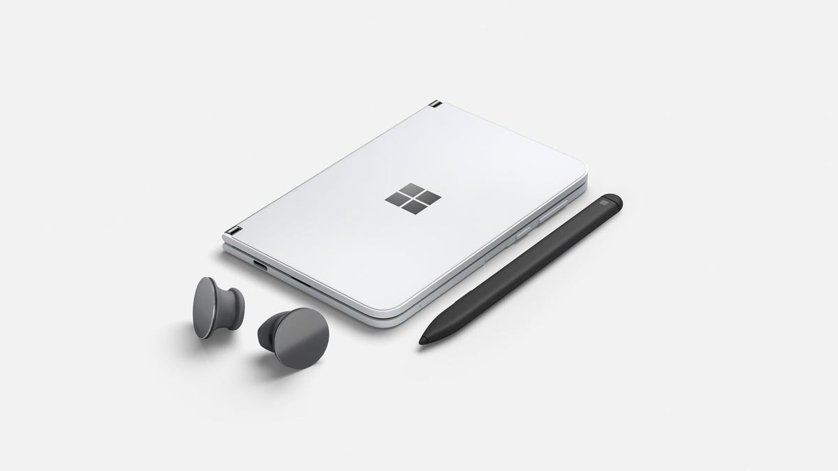 A Surface Duo next to Surface buds and a pen
