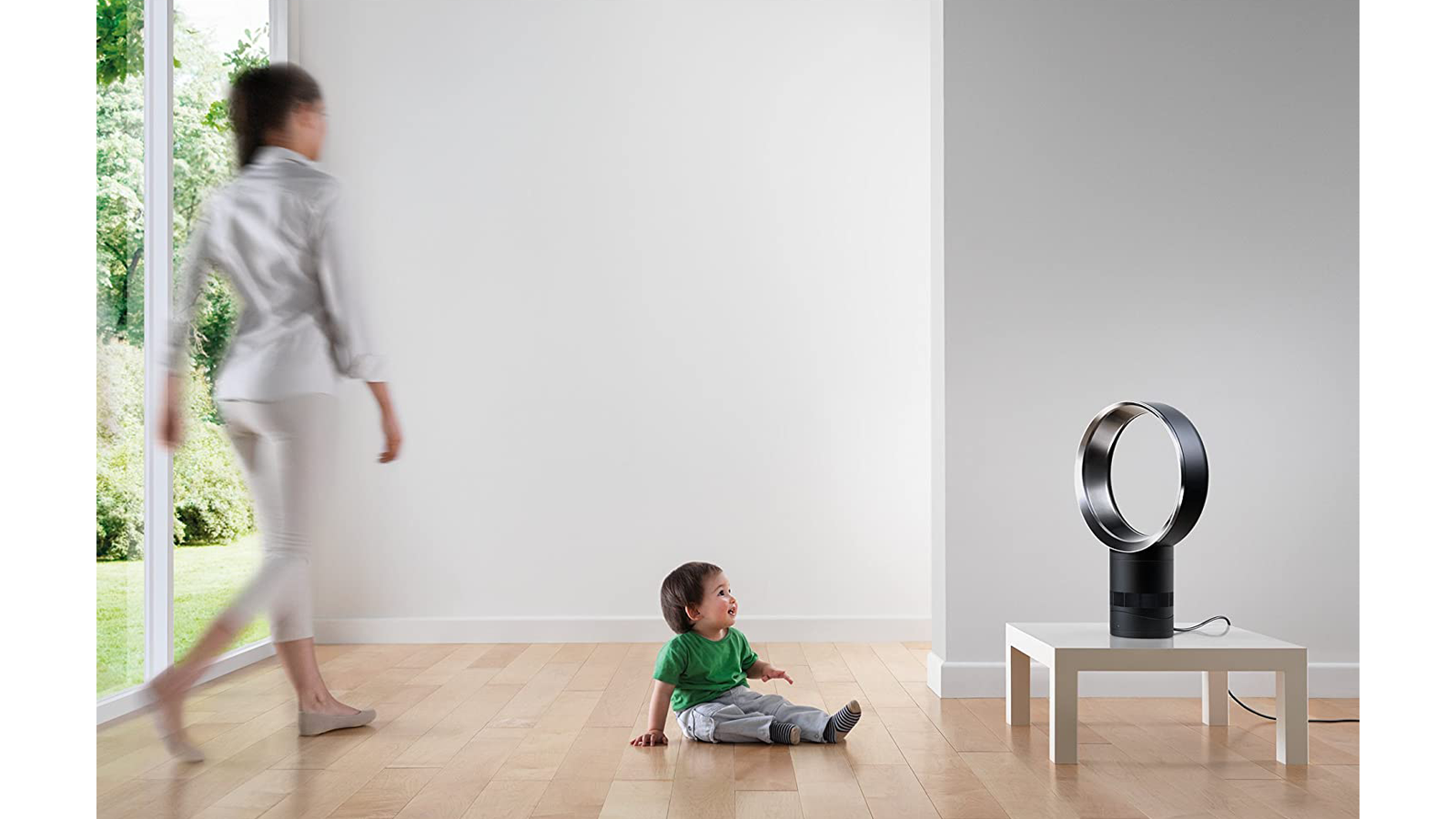 Dyson Air Multiplier AM06 premium bladeless fan in a living room with a mom and baby