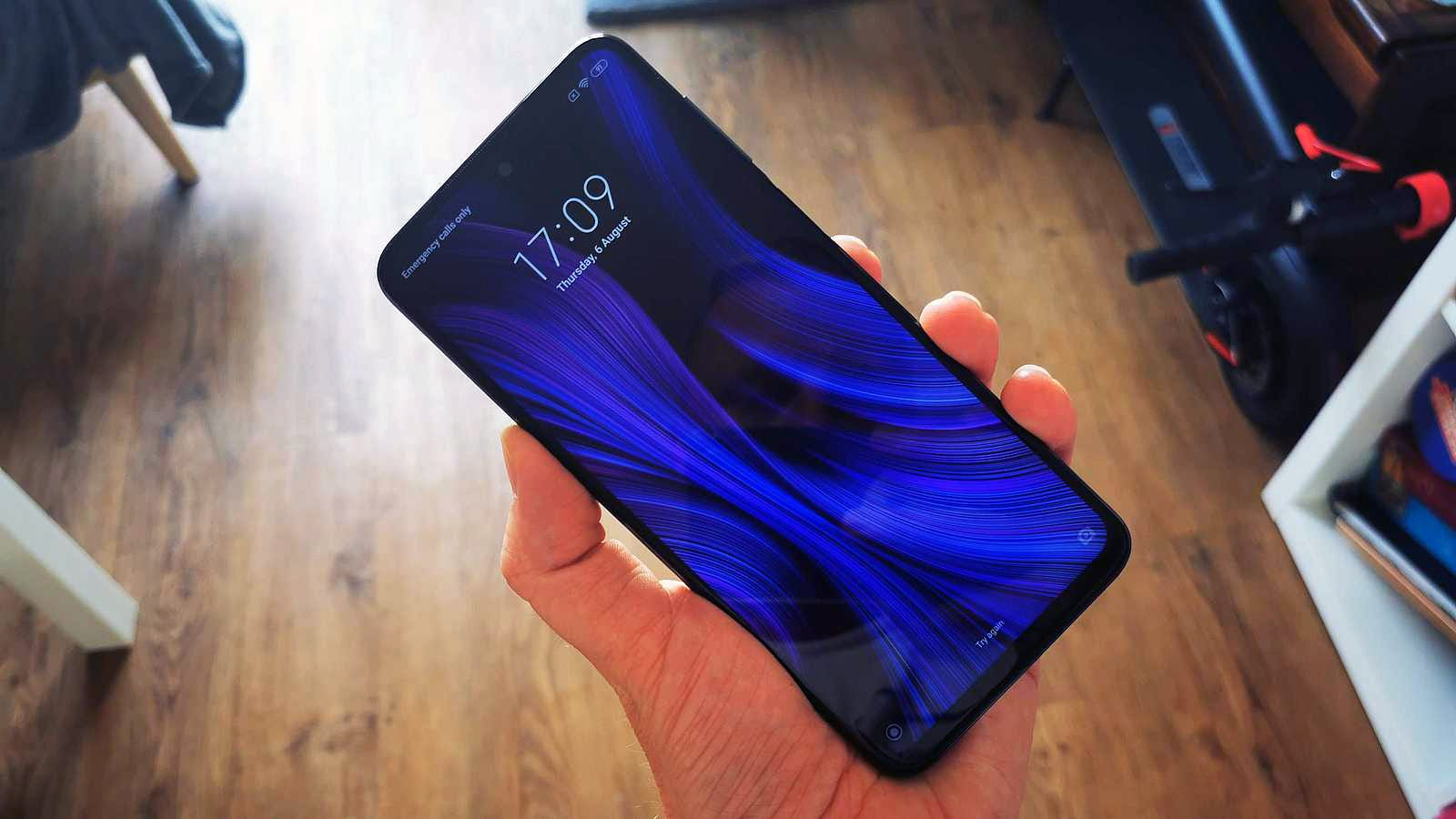 Picture of a Xiaomi Redmi Note 9 Pro being held in a hand.