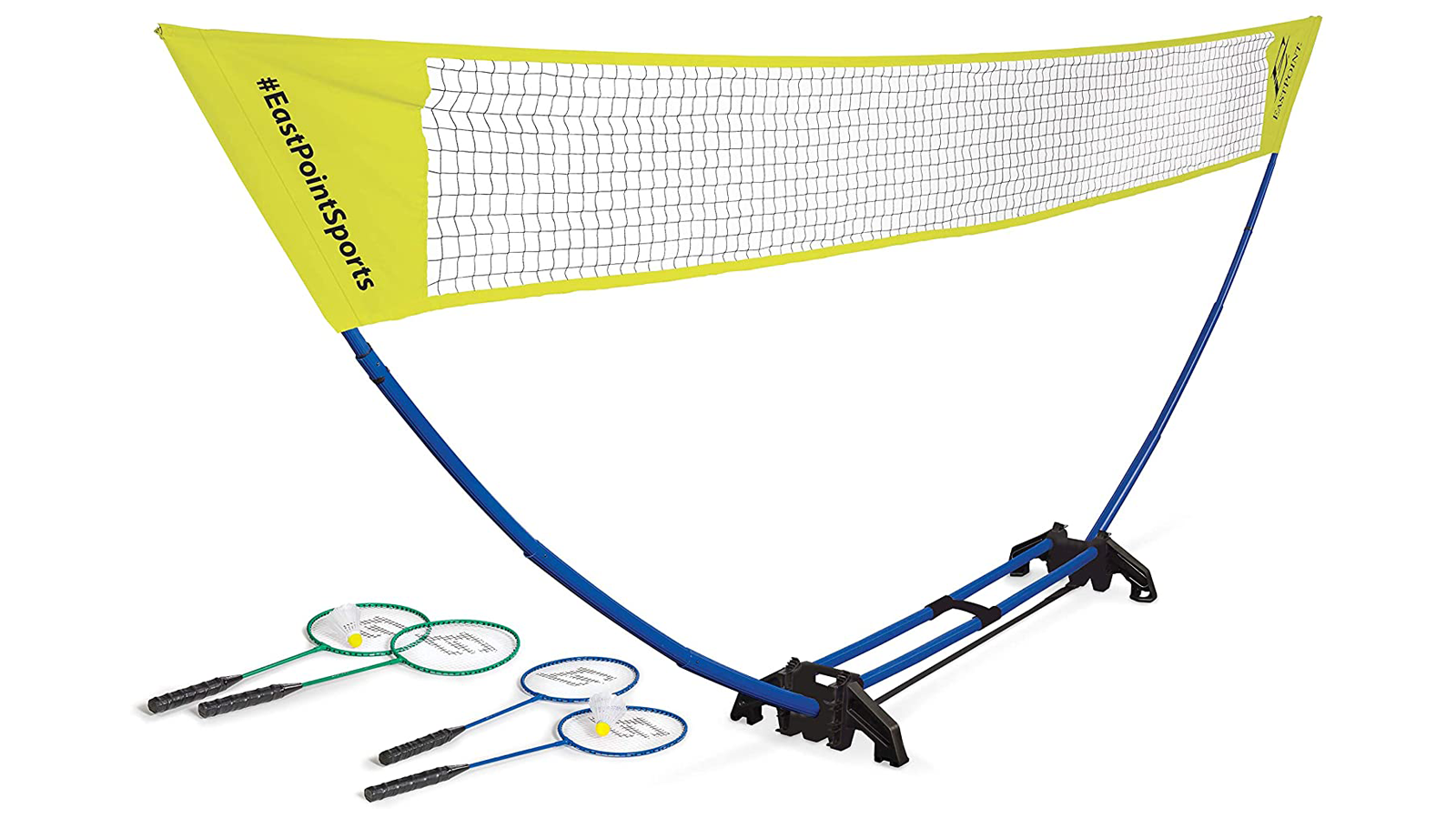 A badminton game setup with a net, rackets, and shuttlecocks