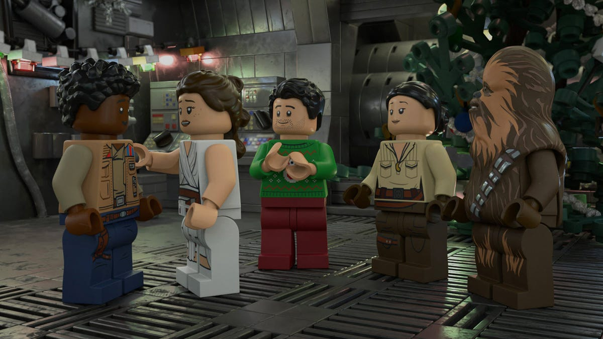 Rey, Finn, Poe, Rose, and Chewbacca in LEGO form in conversation.
