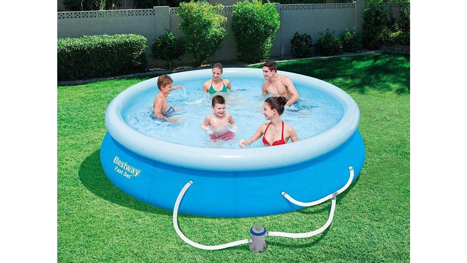 A family enjoying swimming in an above-ground pool in their backyard