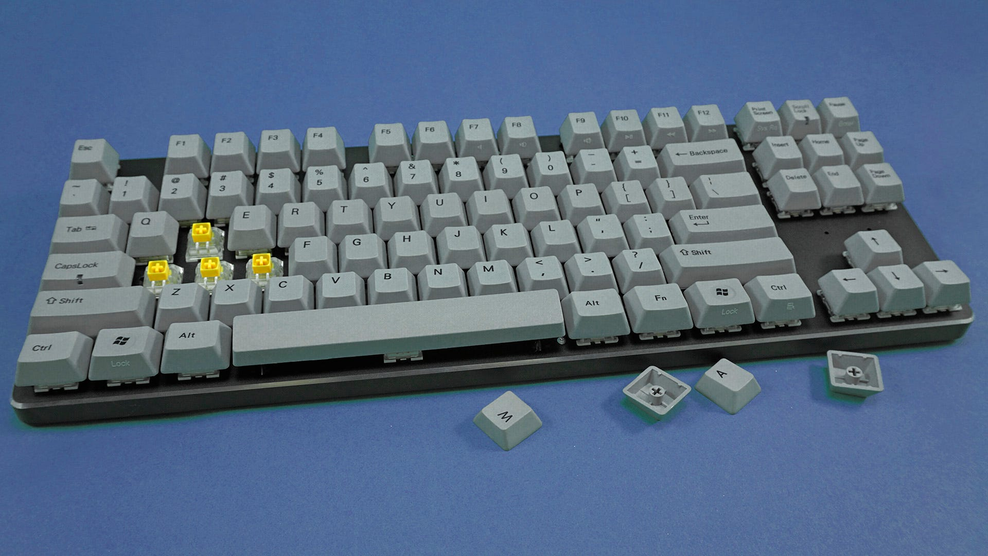GMMK from the front, with WASD keycaps removed.