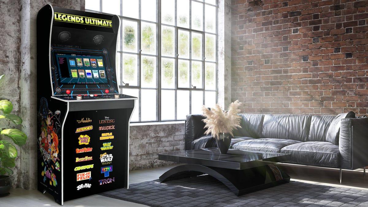 A Legends Ultimate arcade machine in a living room.