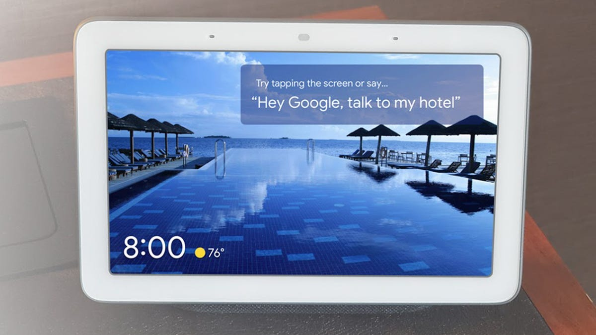 """A Nest hub with the words """"Talk to my Hotel"""" on it."""