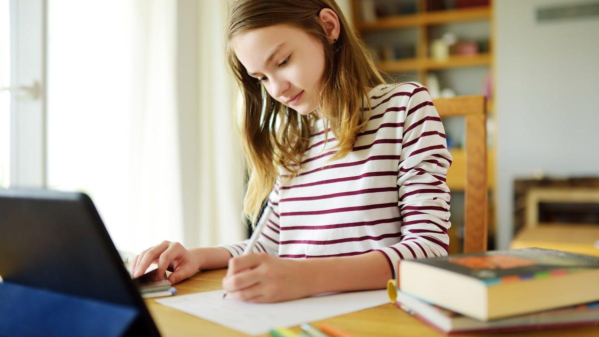 Girl doing homework on an iPad