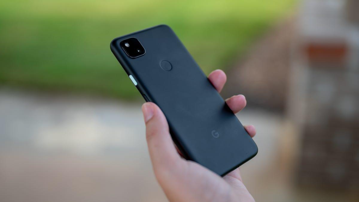 Google Pixel 4a in-hand showing its rear fingerprint sensor