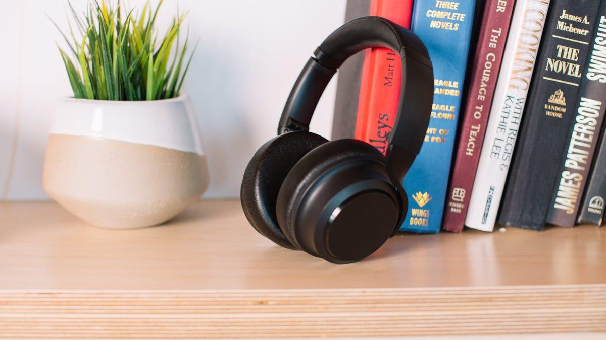 A set of Wyze Headphones on a bookcase.