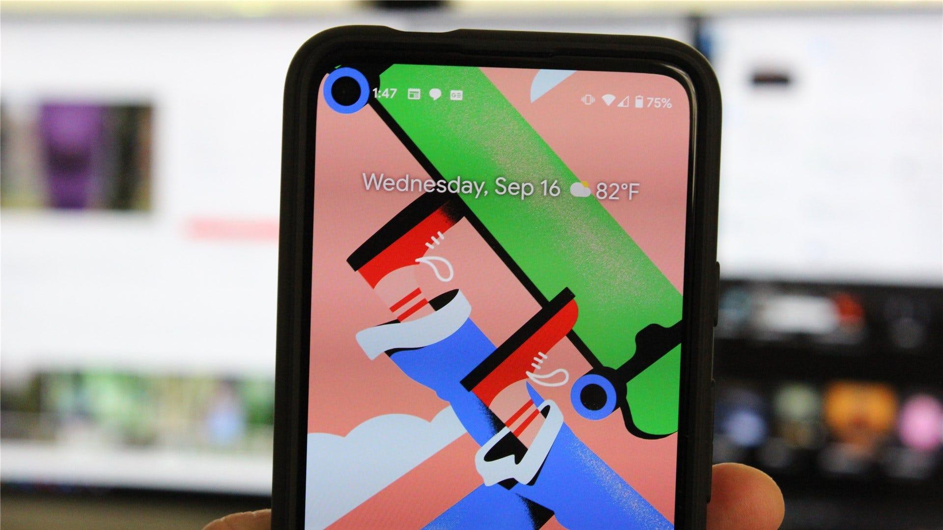 The Google Pixel 4a with a hidden hole punch wallpaper