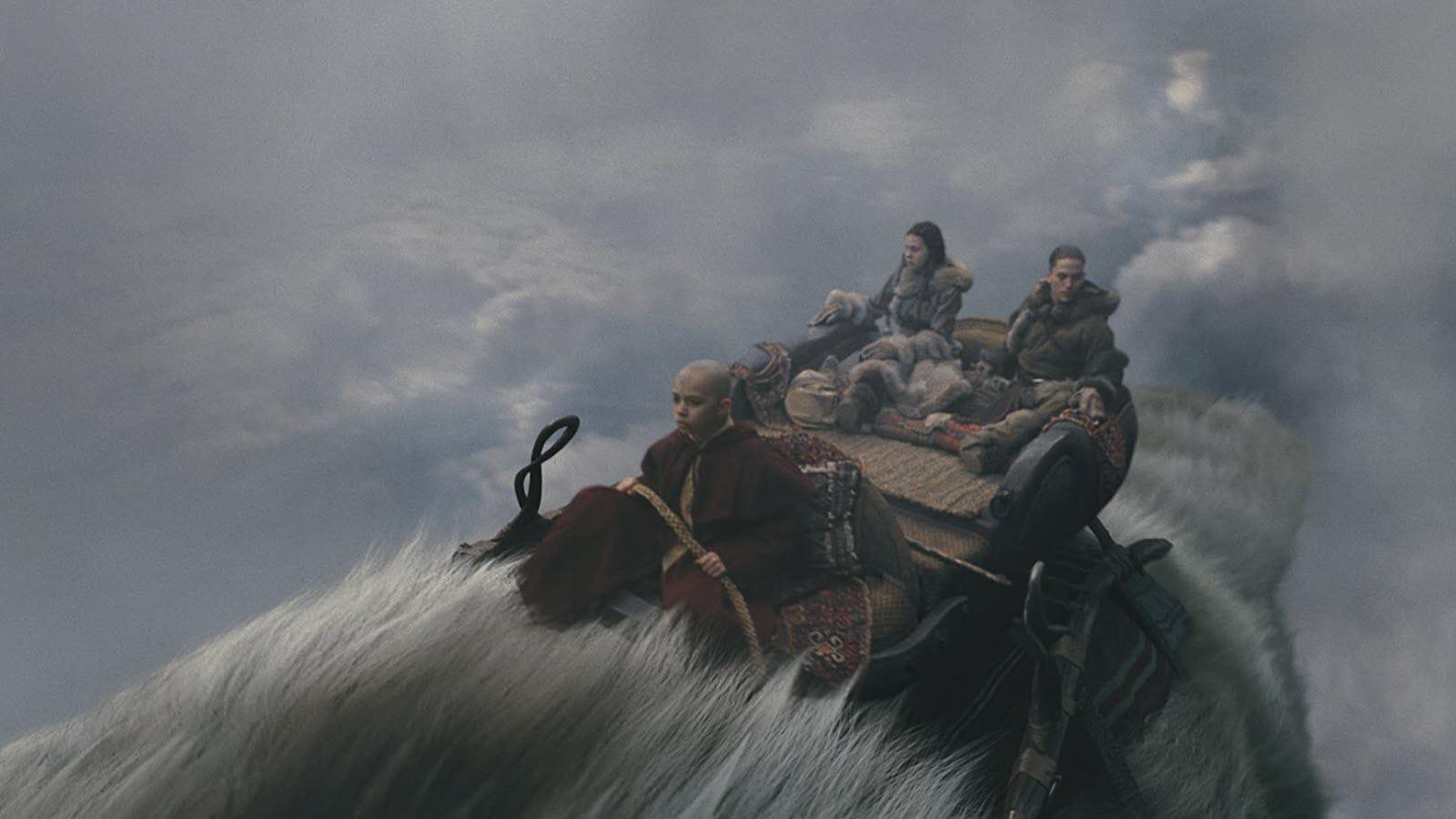 Katara, Aang, and Sokka flying on Appa.