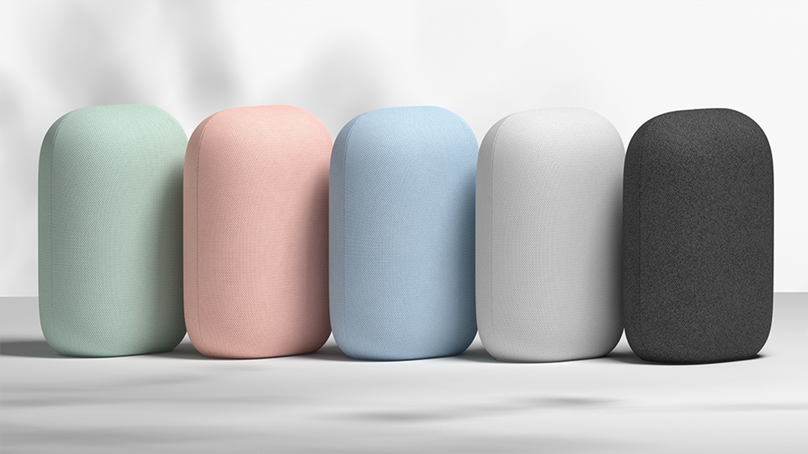 A set of Nest Audio speakers in Sage, Sand, Sky, Charcoal, and Chalk colors.