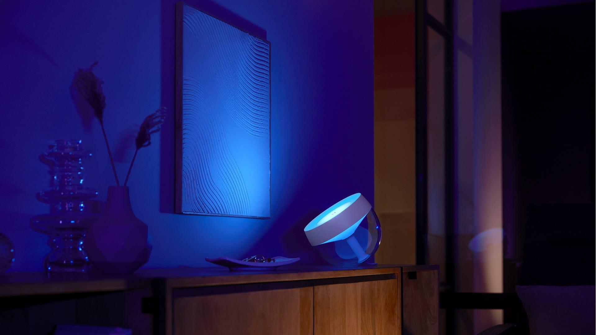 An Iris lamp shining blue light diagonally at a wall.
