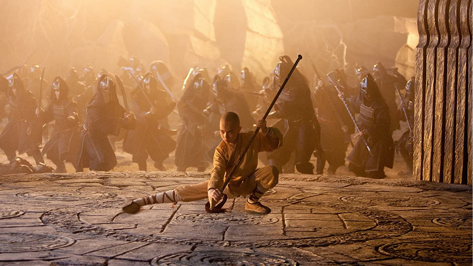 Aang surrounded by blurry enemies.
