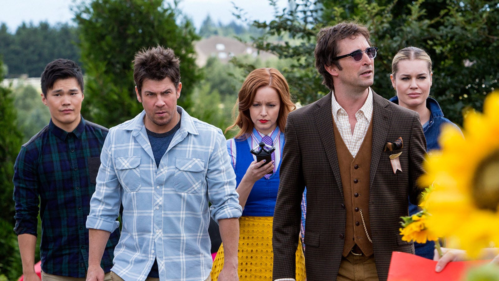 The main characters from The Librarians, one holding a 'Ghostbusters' style handscanner.