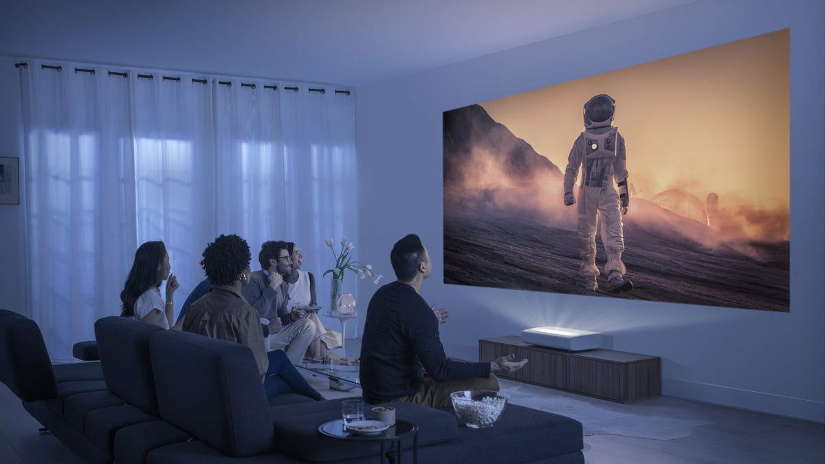 A projector directly against the wall displaying a large image.