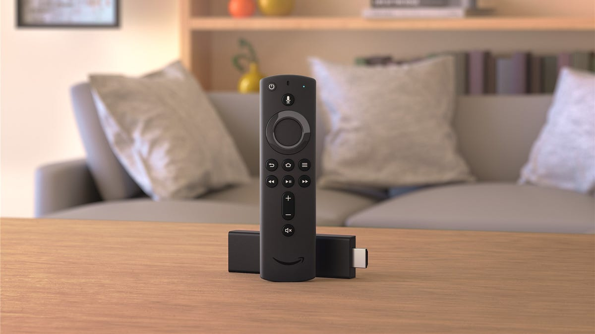 The Amazon Fire Stick in a living room. Showing the new voice remote.