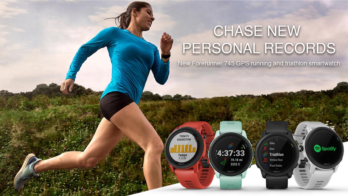 Triathlete running on open course while wearing the Garmin Forerunner 745 watch