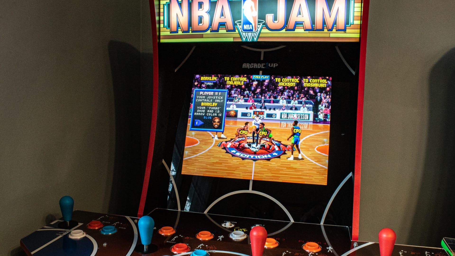 A closeup shot of the NBA Jam machine playing a game.
