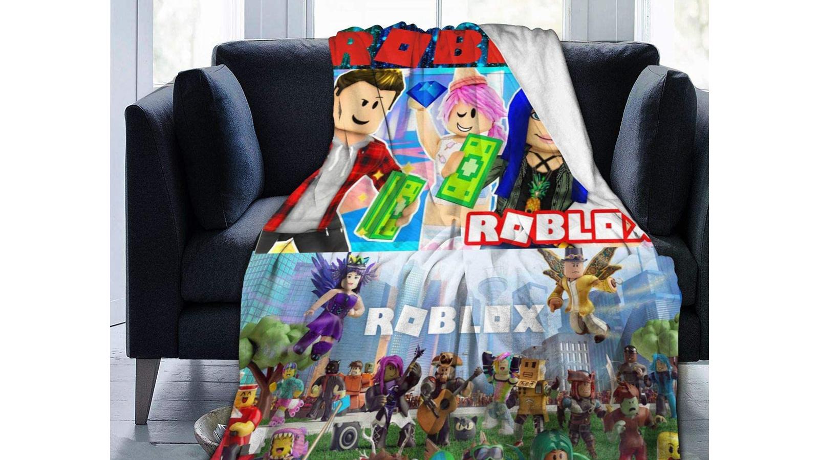 A Roblox Flannel Fleece Throw Blanket thrown over a chair.