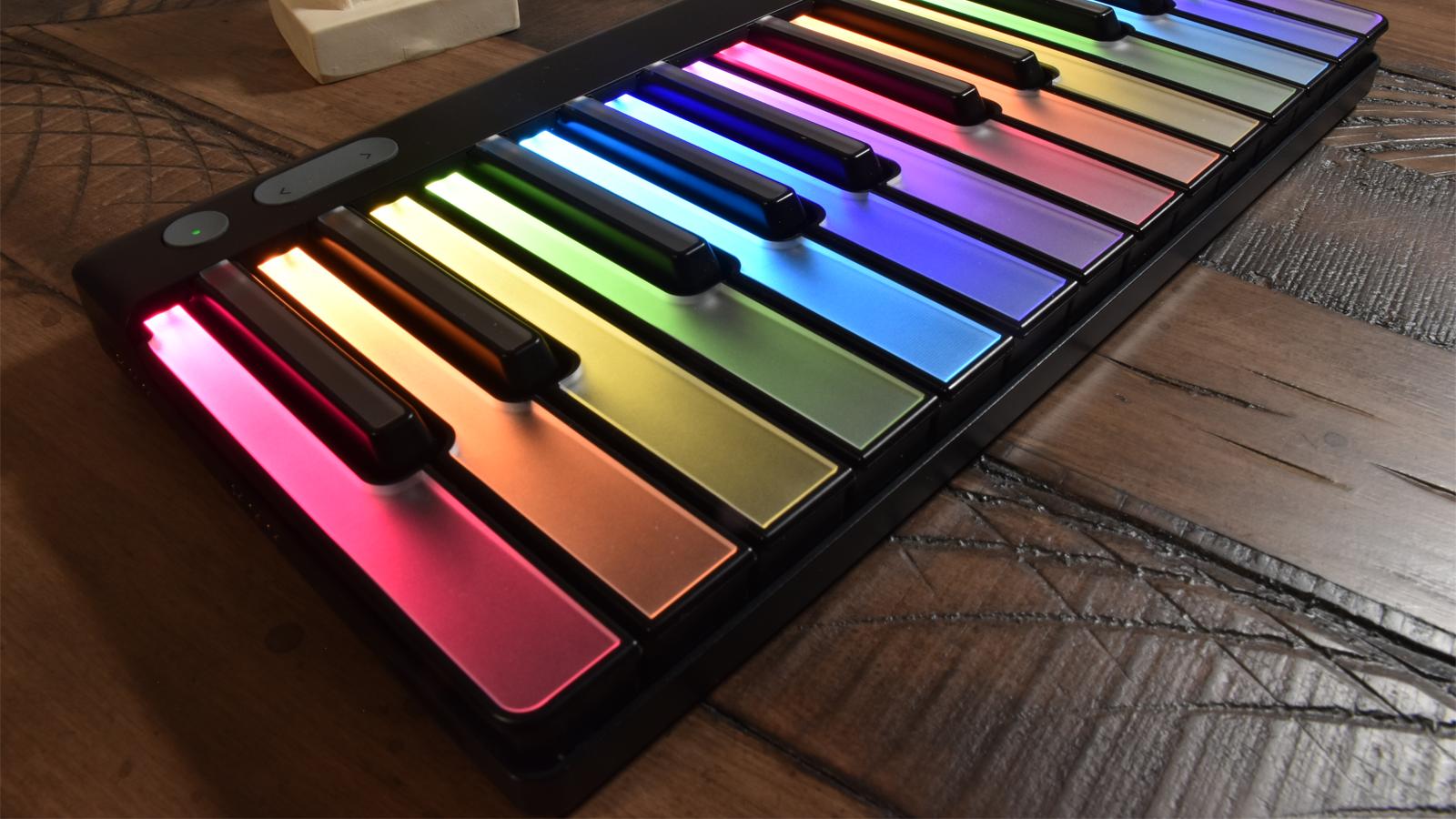 LUMI Keys keyboard at an angle on wooden table