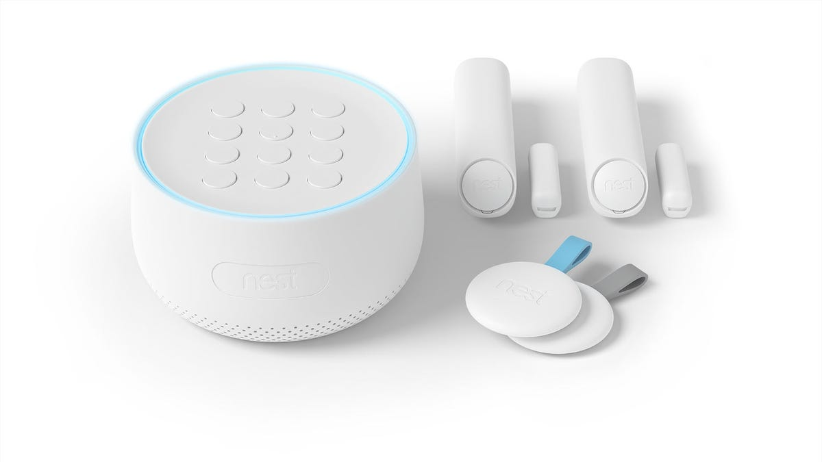 A Nest Secure device with trackers and keyfobs.