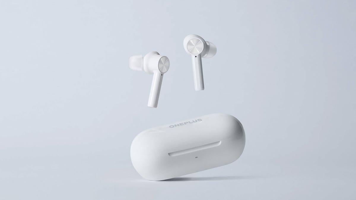 A set of OnePlus Bud Z earbuds against a grey background.