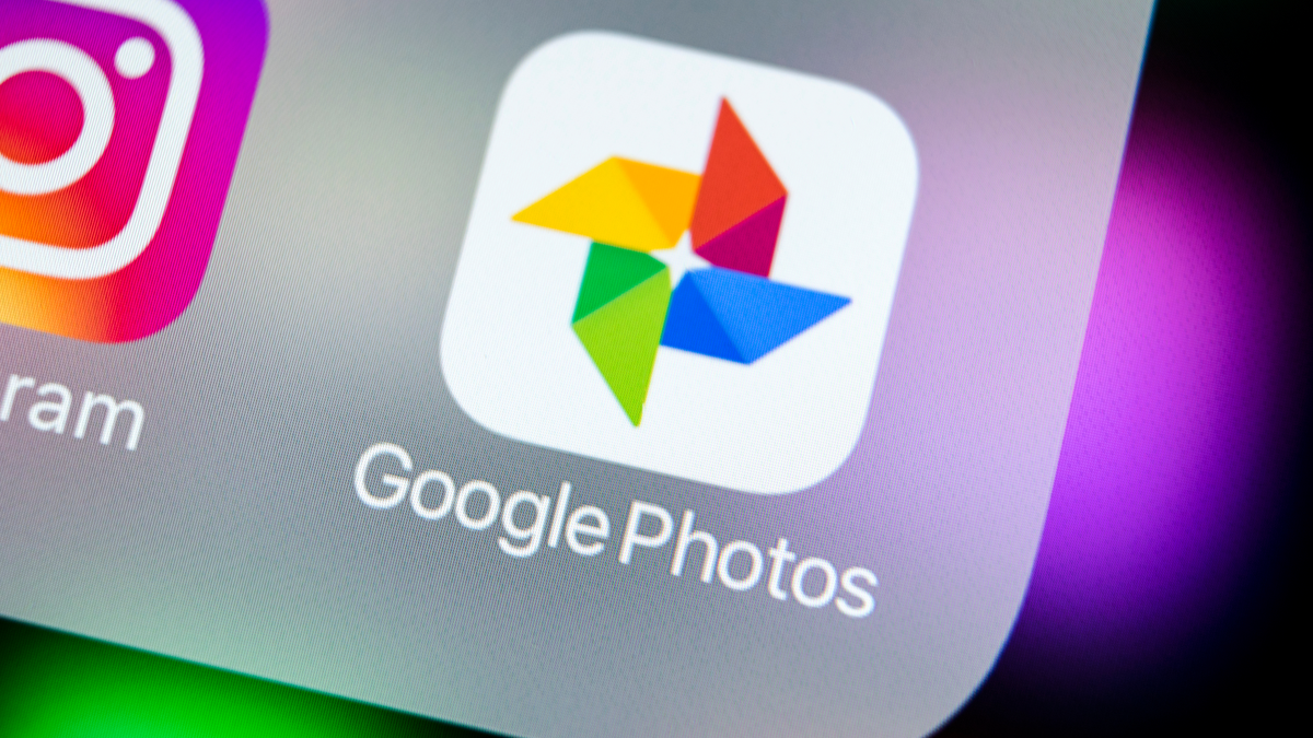 Google Photos smartphone application icon on iPhone X screen close up