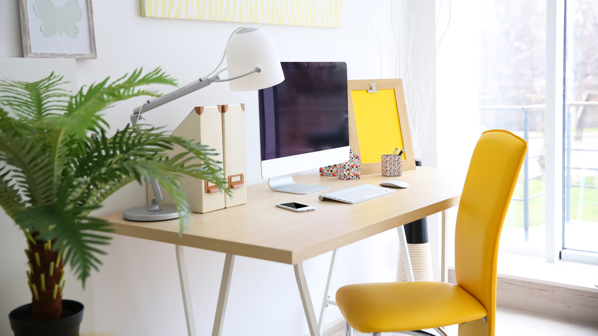 Stylish workplace with computer at home