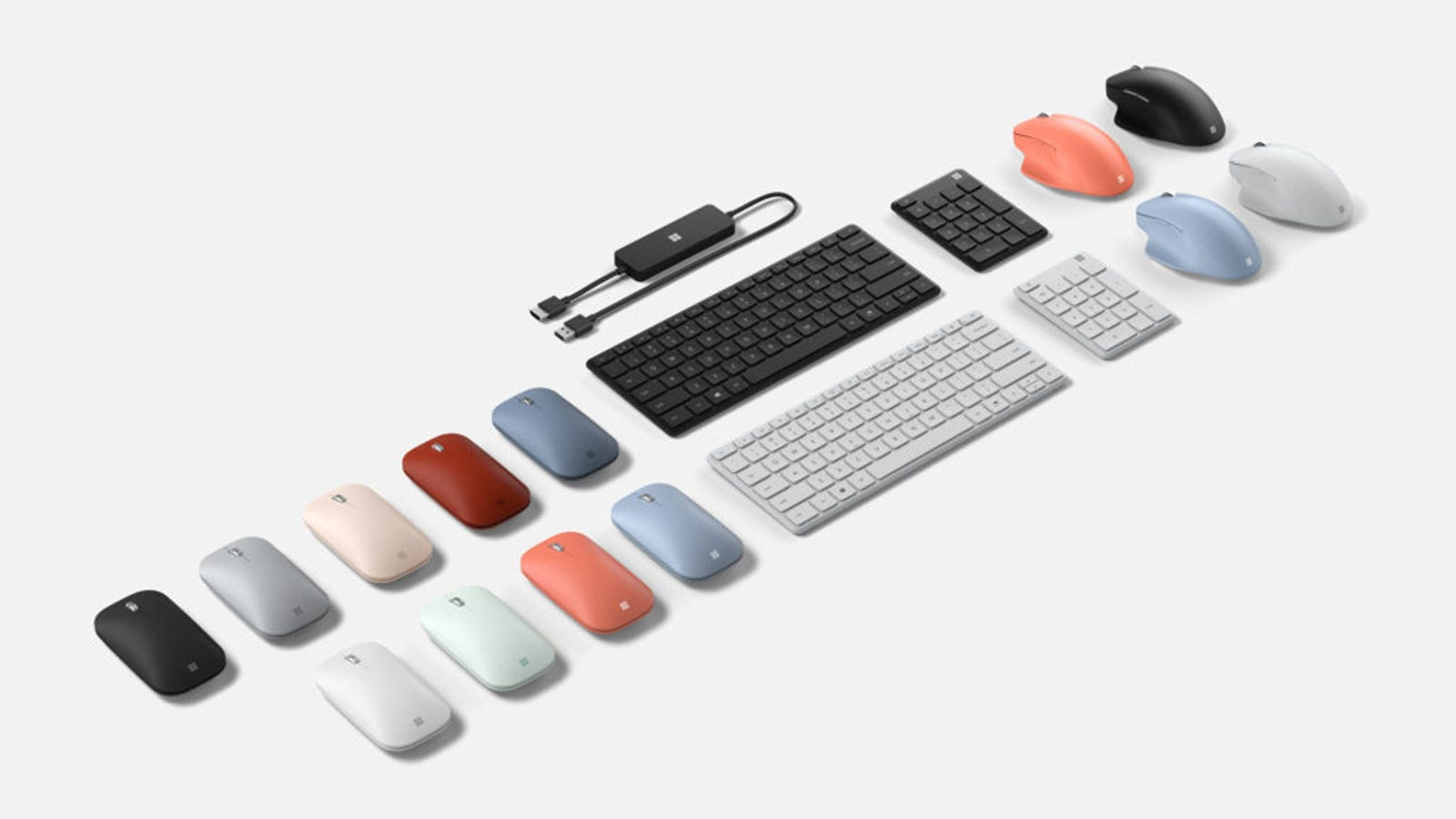 Microsoft keyboards, numpads, an ergonomic mouse and a mobile mouse, and a 4K Wireless display adapter.