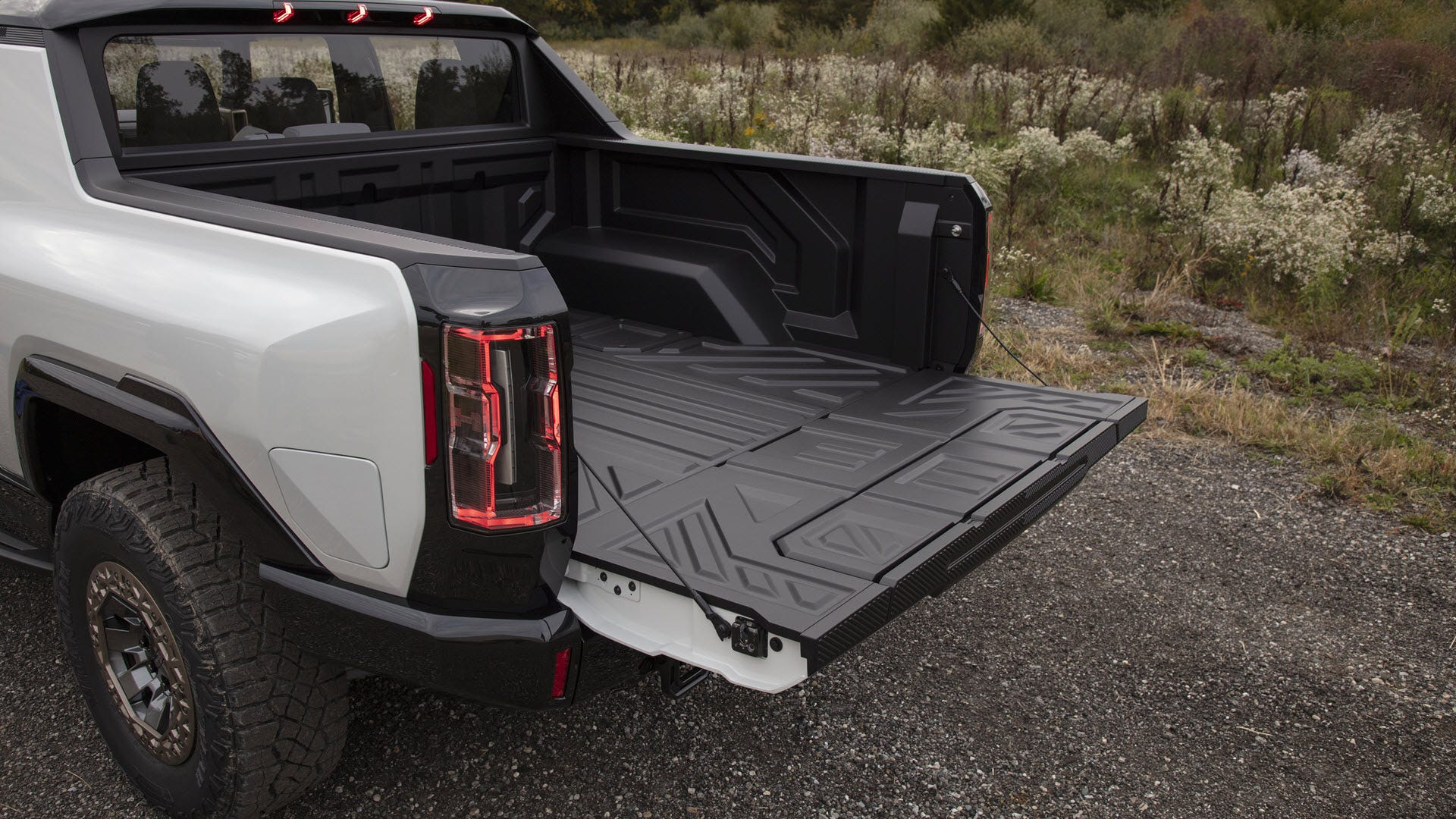 The tailgate of the GMC Hummer EV, with a step built into it.