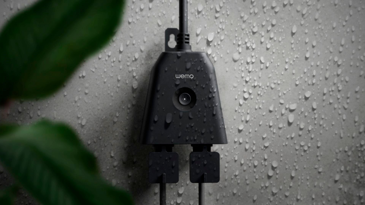 A photo of the Wemo outdoor smart plug in the rain.