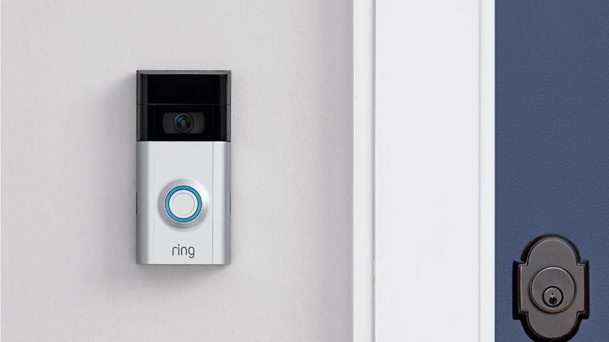 A Ring Video Doorbell 2 mounted to a home.
