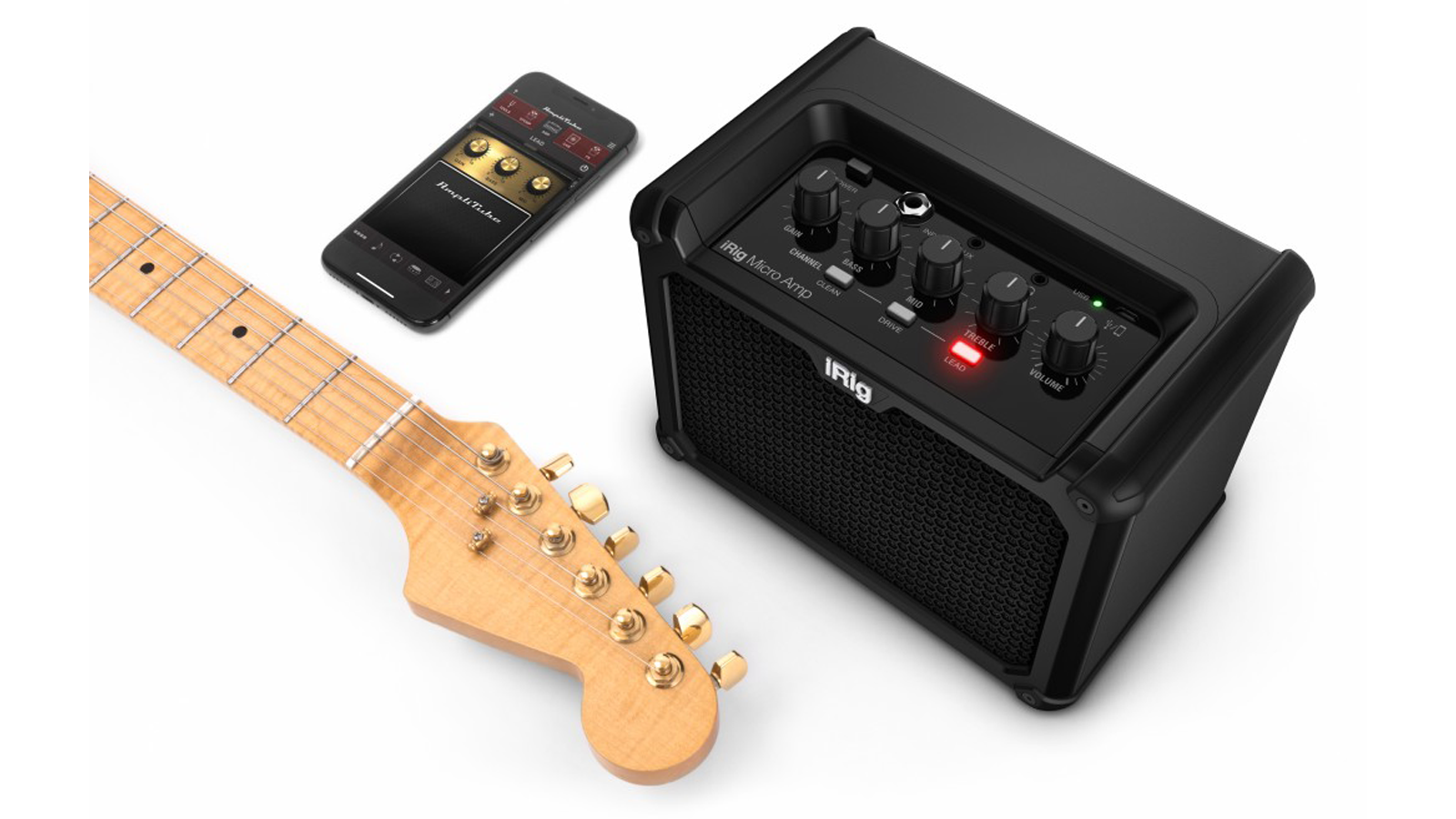 IK Multimedia iRig Micro Amp with guitar and smartphone