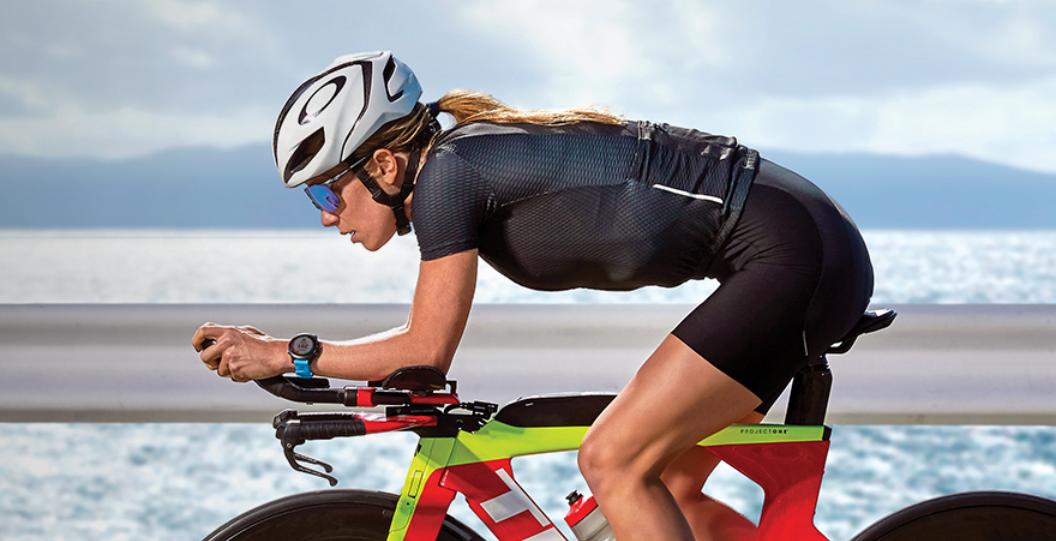 woman using garmin forerunner 945 on a bike